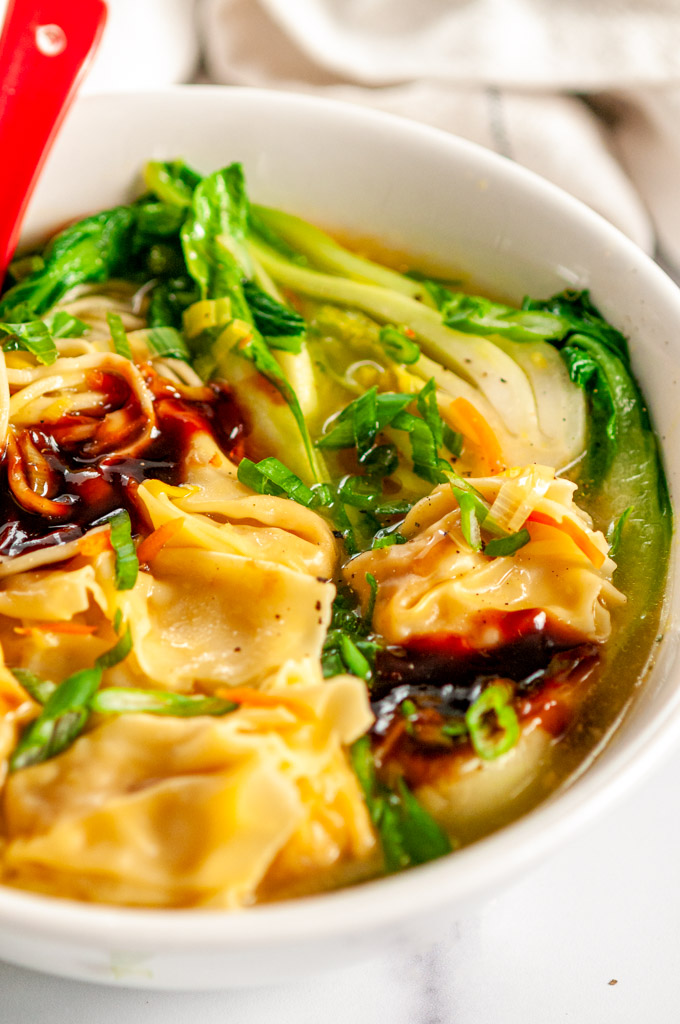 Quick 20 Minute Wonton Soup in white bowl on marble close up