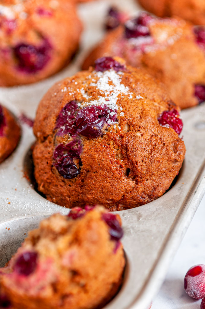 Easy Autumn Chai Spice Cranberry Muffins in muffin tin on white marble